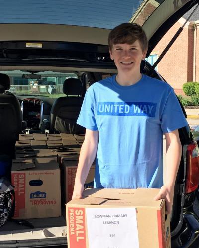 Casey Volunteering for Summer Slide Delivery